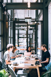 Millennial_Workers_Collaborating_In_Office